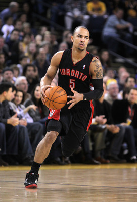 OAKLAND, CA - MARCH 25:  Jerryd Bayless #5 of the Toronto Raptors in action against the Golden State Warriors at Oracle Arena on March 25, 2011 in Oakland, California. NOTE TO USER: User expressly acknowledges and agrees that, by downloading and or using
