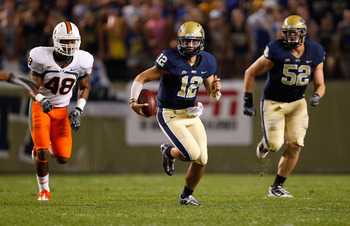 PITTSBURGH - SEPTEMBER 23:  Tino Sunseri #12 of the Pittsburgh Panthers runs with the ball against the Miami Hurricanes on September 23, 2010 at Heinz Field in Pittsburgh, Pennsylvania.  (Photo by Jared Wickerham/Getty Images)