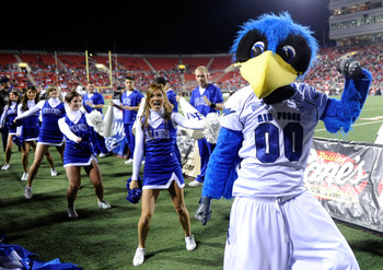 LAS VEGAS - NOVEMBER 18:  The Air Force Falcons mascot The Bird performs with cheerleaders during the team's game against the UNLV Rebels at Sam Boyd Stadium November 18, 2010 in Las Vegas, Nevada. Air Force won 35-20.  (Photo by Ethan Miller/Getty Images