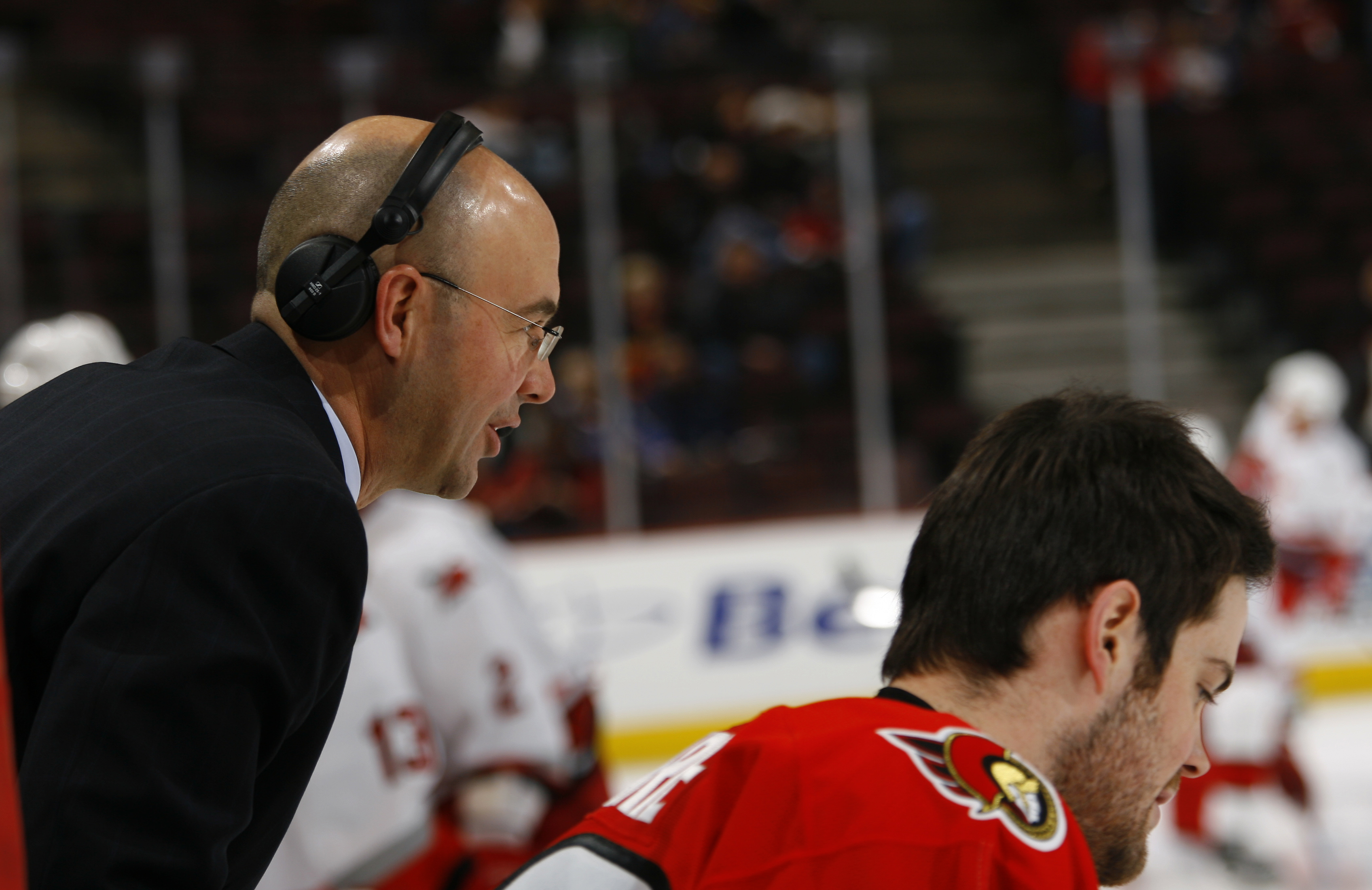 Pierre McGuire seen here whispering sweet nothings to Mike Comrie.