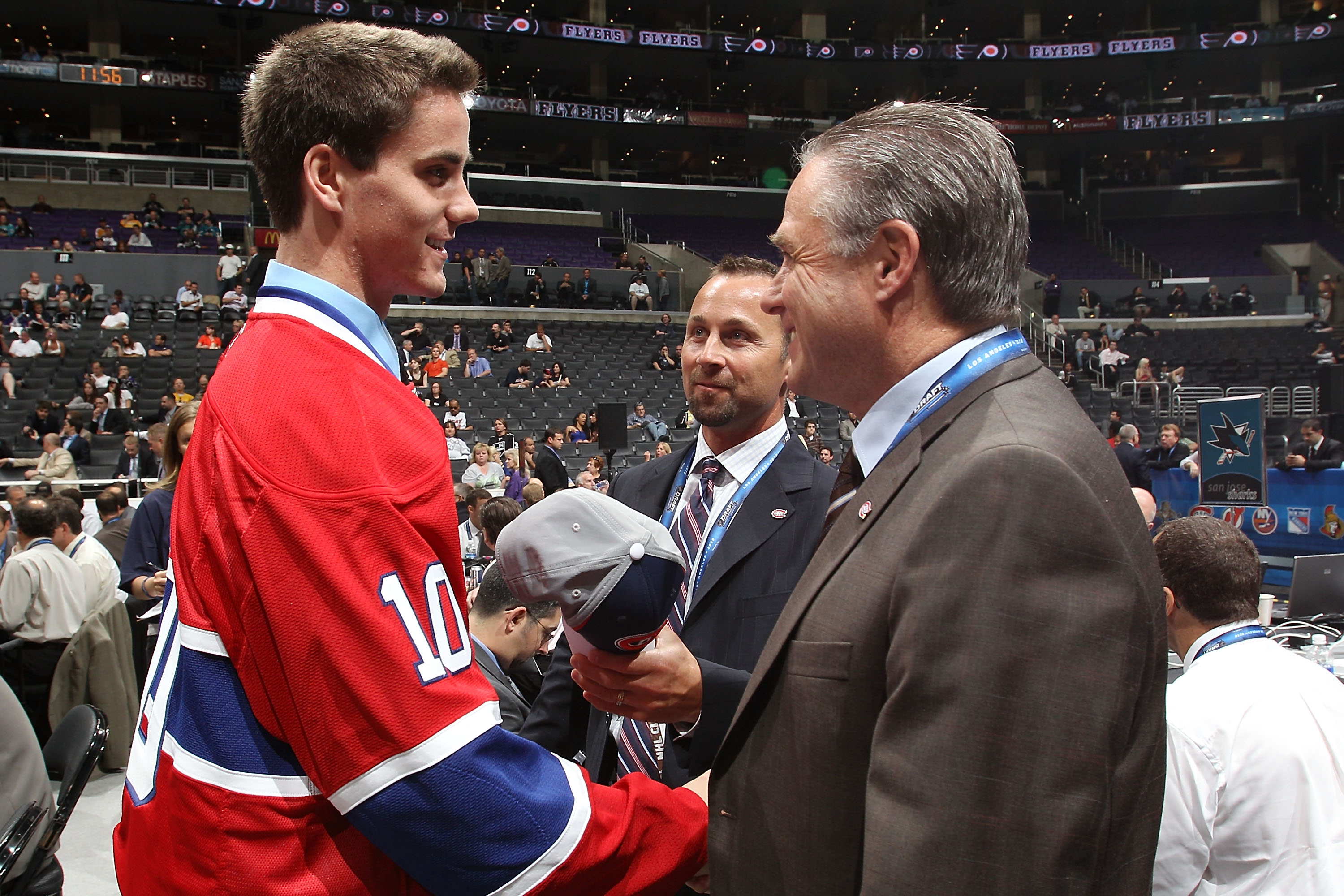 LOS ANGELES, CA - JUNE 26:  Morgan Ellis speaks with team personnel after being drafted in the fourth round by the Montreal Canadiens during day two of the 2010 NHL Entry Draft at Staples Center on June 26, 2010 in Los Angeles, California.  (Photo by Bruc