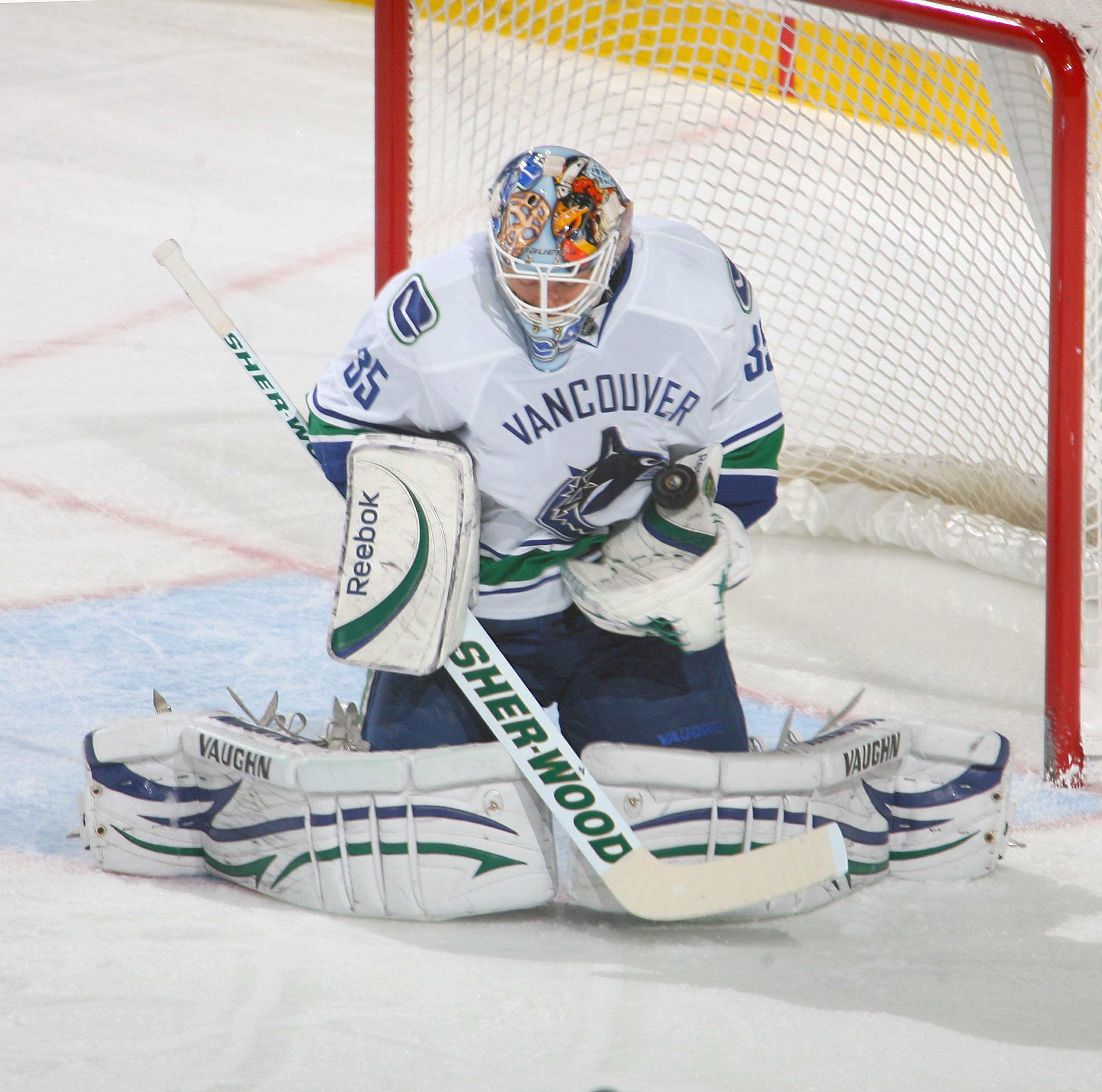 BUFFALO, NY - NOVEMBER 15:  Corey Schneider #35 of the Vancouver Canucks makes a save against the Buffalo Sabres  at HSBC Arena on November 15, 2010 in Buffalo, New York. Buffalo won 4-3 in overtime.  (Photo by Rick Stewart/Getty Images)