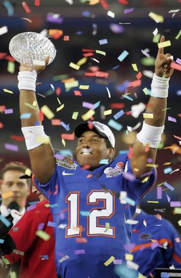 GLENDALE, AZ - JANUARY 08:  Quarterback Chris Leak #12 of the Florida Gators celebrates with the BCS championship trophy after defeating the Ohio State Buckeyes after the 2007 Tostitos BCS National Championship Game at the University of Phoenix Stadium on