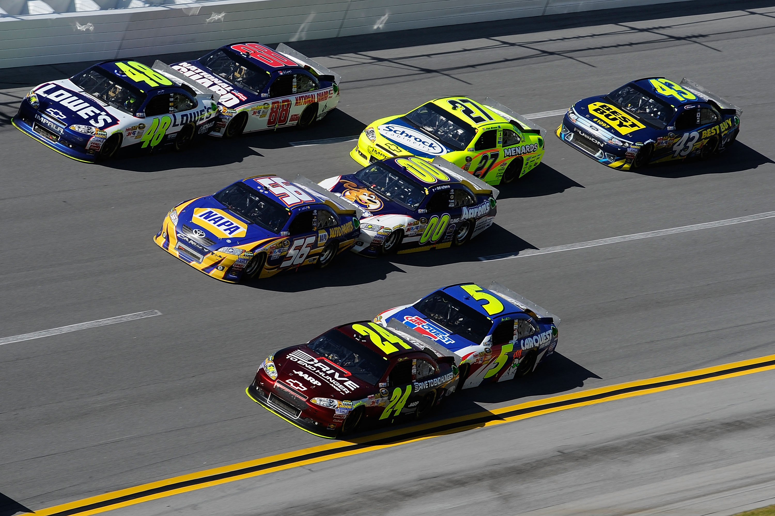 TALLADEGA, AL - APRIL 17:  Jimmie Johnson, driver of the #48 Lowe's Chevrolet, Martin Truex Jr., driver of the #56 NAPA Toyota, and Jeff Gordon, driver of the #24 Drive To End Hunger/AARP Chevrolet, lead the field during the NASCAR Sprint Cup Series Aaron