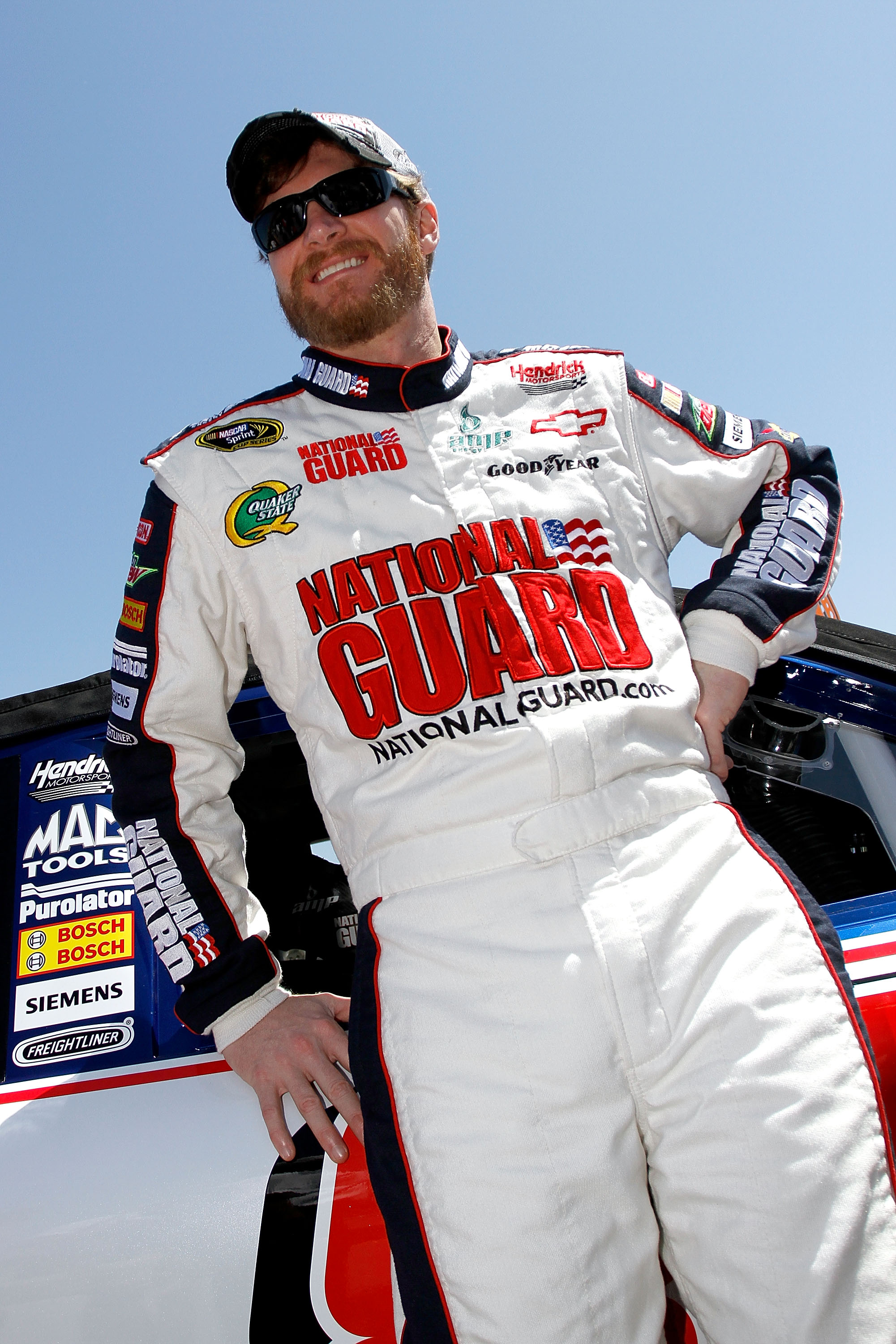 TALLADEGA, AL - APRIL 17:  Dale Earnhardt Jr., driver of the #88 National Guard/Amp Energy Chevrolet, stands on the grid prior to the start of the NASCAR Sprint Cup Series Aaron's 499 at Talladega Superspeedway on April 17, 2011 in Talladega, Alabama.  (P