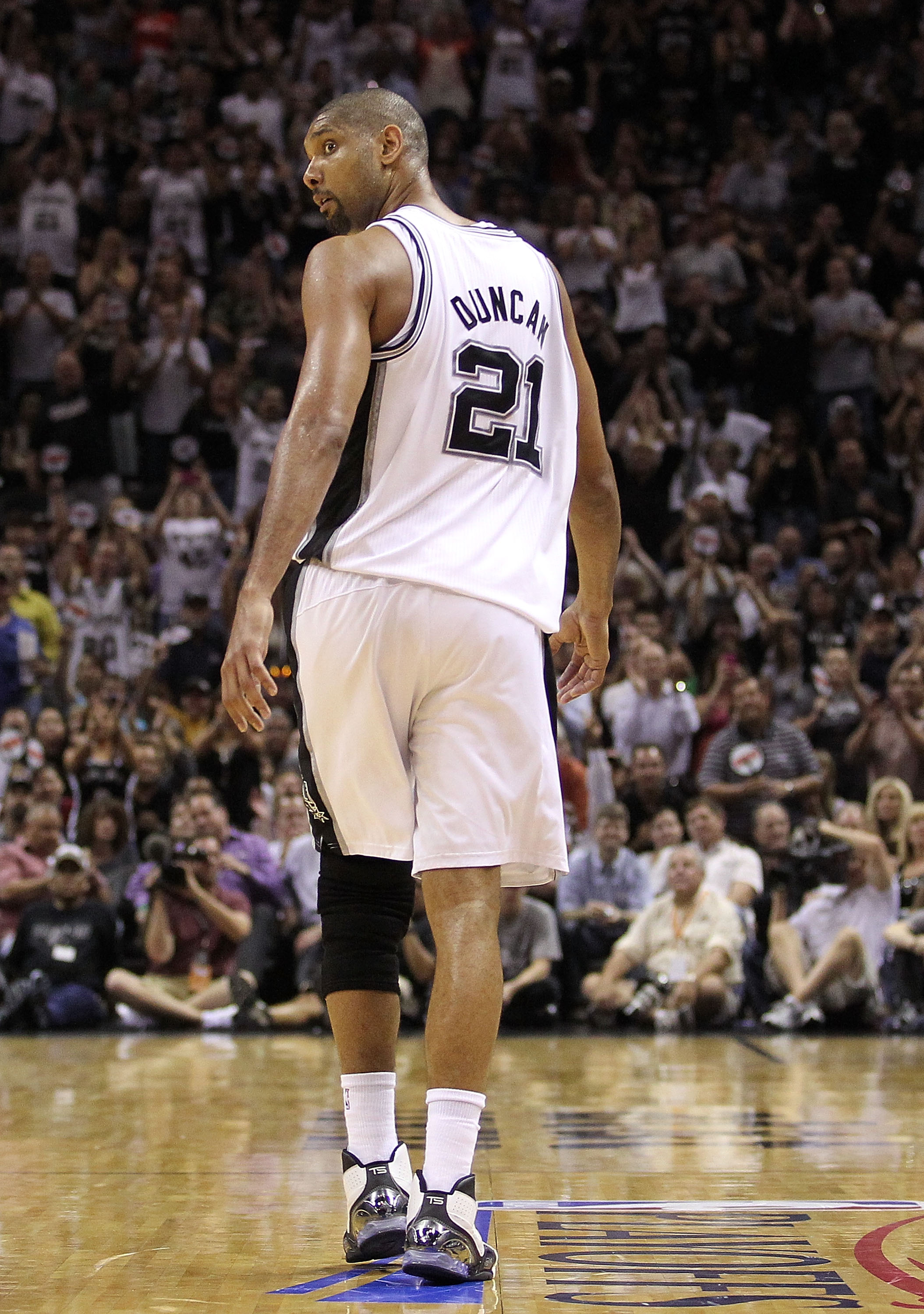 SAN ANTONIO, TX - APRIL 20:  Forward Tim Duncan #21 of the San Antonio Spurs walks off the court after fouling out against the Memphis Grizzlies in Game Two of the Western Conference Quarterfinals in the 2011 NBA Playoffs on April 20, 2011 at AT&T Center