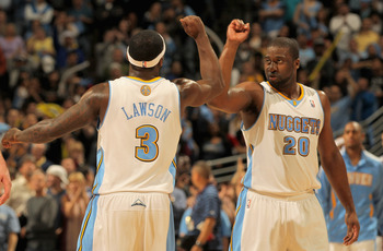 DENVER, CO - APRIL 25:  Ty Lawson #3 of the Denver Nuggets and Raymond Felton #20 of the Denver Nuggets celebrate late in the fourth quarter against the Oklahoma City Thunder in Game Four of the Western Conference Quarterfinals in the 2011 NBA Playoffs on