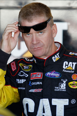RICHMOND, VA - SEPTEMBER 10:  Jeff Burton, driver of the #31 Caterpilliar Chevrolet, stands in the garage during practice for the NASCAR Sprint Cup Series Air Guard 400 at Richmond International Raceway on September 10, 2010 in Richmond, Virginia.  (Photo