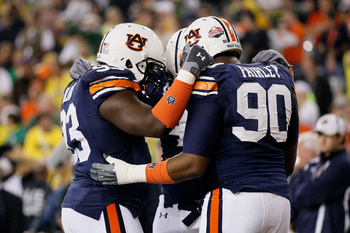 GLENDALE, AZ - JANUARY 10:  Nick Fairley #90 of the Auburn Tigers huddles with members of the Tigers defense during the Tostitos BCS National Championship Game at University of Phoenix Stadium on January 10, 2011 in Glendale, Arizona.  (Photo by Kevin C.