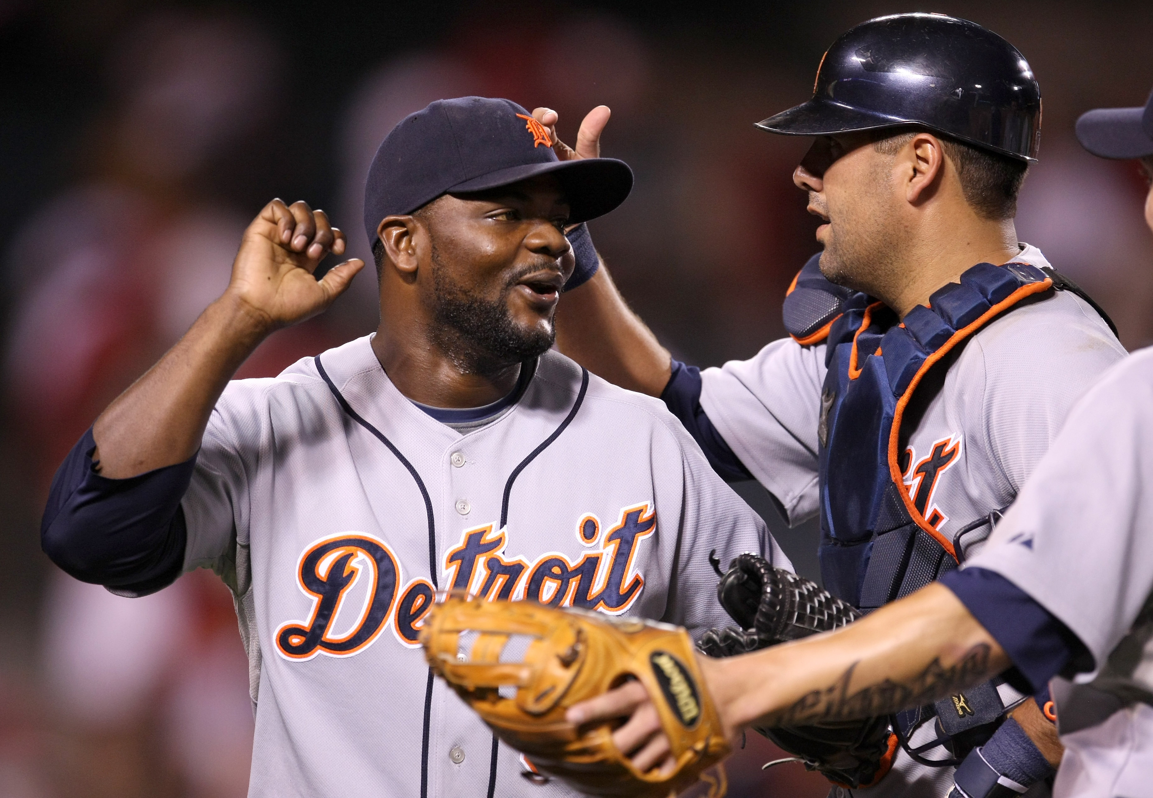 ANAHEIM, CA - AUGUST 24:  Closer Fernanado Rodney #56 and catcher Gerald Laird #8 of the Detroit Tigers celebrate after the game against the Los Angeles Angels of Anaheim on August 24, 2009 at Angel Stadium in Anaheim, California.  Rodney picked up his 27