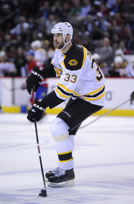 MONTREAL, CANADA - APRIL 26:  Zdeno Chara #33 of the Boston Bruins carries the puck up ice in Game Six of the Eastern Conference Quarterfinals against the Montreal Canadiens during the 2011 NHL Stanley Cup Playoffs at the Bell Centre on April 26, 2011 in