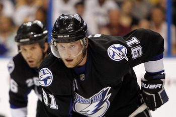 TAMPA, FL - APRIL 18: Steven Stamkos #91 of the Tampa Bay Lightning faces off against the Pittsburgh Penguins in Game Three of the Eastern Conference Quarterfinals during the 2011 NHL Stanley Cup Playoffs at the St. Pete Times Forum on April 18, 2011 in T