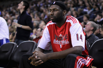 OAKLAND, CA - MARCH 25: Julian Wright #14 of the Toronto Raptors sits on the bench during their loss to the Golden State Warriors at Oracle Arena on March 25, 2011 in Oakland, California. NOTE TO USER: User expressly acknowledges and agrees that, by downl