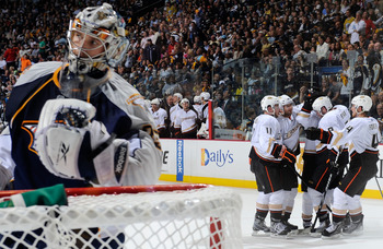 NASHVILLE, TN - APRIL 24:  Saku Koivu #11 and Cam Fowler #4 of the Anaheim Ducks celebrate a goal against Pekka Rinne #35 of the Nashville Predators in Game Six of the Western Conference Quarterfinals during the 2011 NHL Stanley Cup Playoffs at Bridgeston