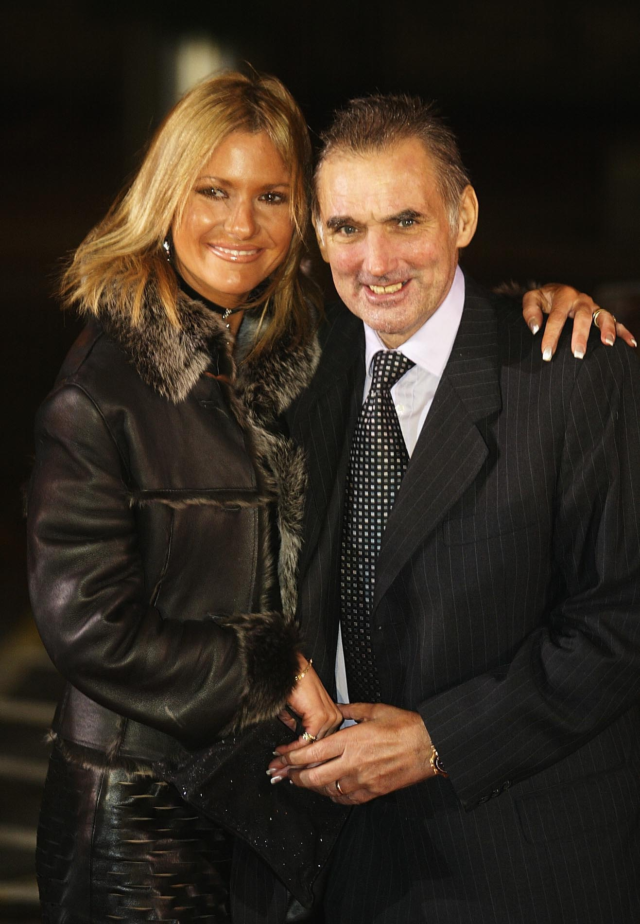 LONDON - DECEMBER 8:   George Best poses with his wife Alex as they arrive for the BBC Sports Personality of the Year Awards held at the BBC Television Centre in London, December 8, 2002. (Photo by Warren Little/Getty Images)