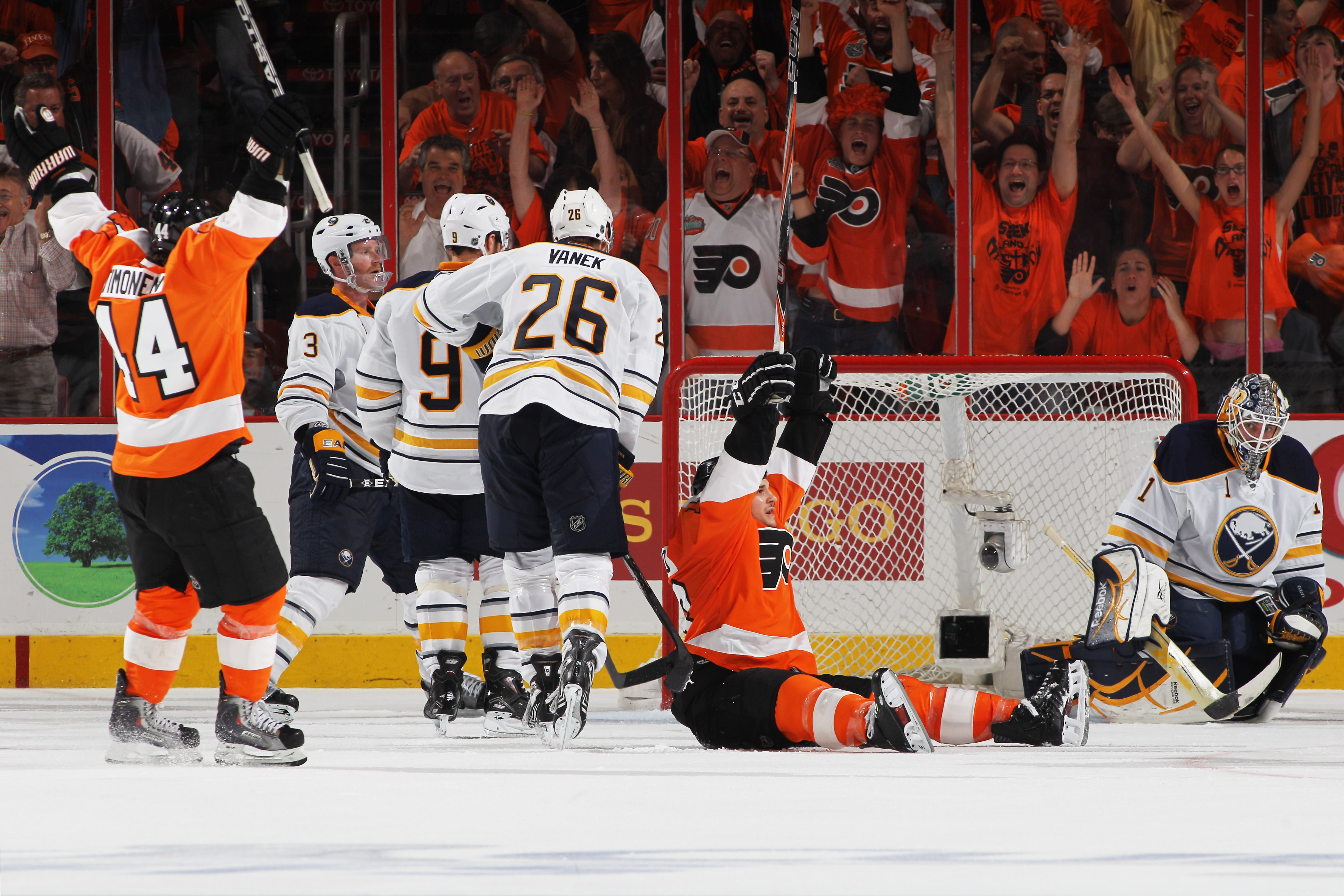 PHILADELPHIA, PA - APRIL 26:  Daniel Carcillo #13 of the Philadelphia Flyers celebrates scoring a third period goal against Jhonas Enroth #1 of the Buffalo Sabres with teammates in Game Seven of the Eastern Conference Quarterfinals during the 2011 NHL Sta
