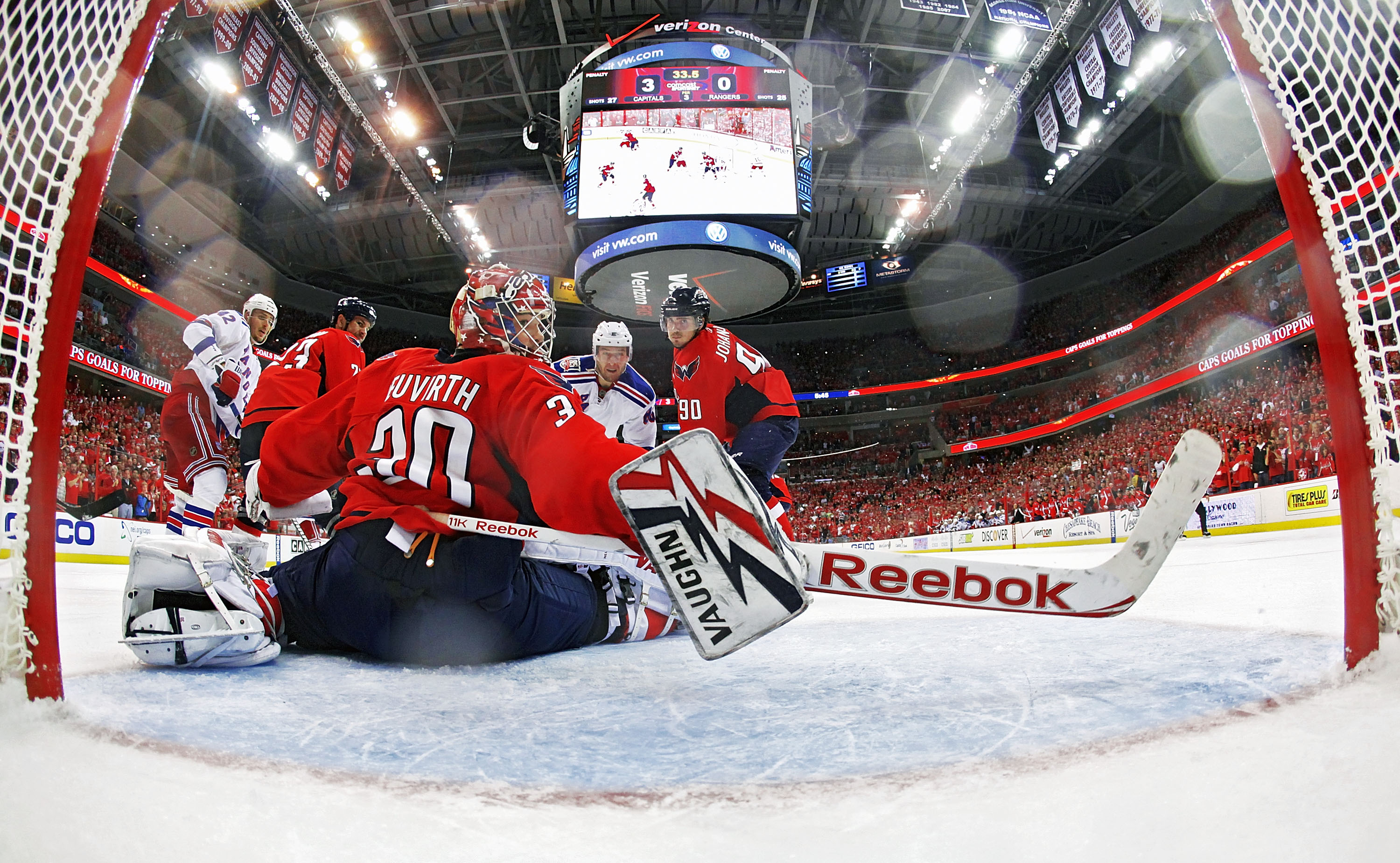 WASHINGTON, DC - APRIL 23:  Michal Neuvirth #30 of the Washington Capitals watches the only goal of the New York Rangers sail into the net in Game Five of the Eastern Conference Quarterfinals during the 2011 NHL Stanley Cup Playoffs at the Verizon Center