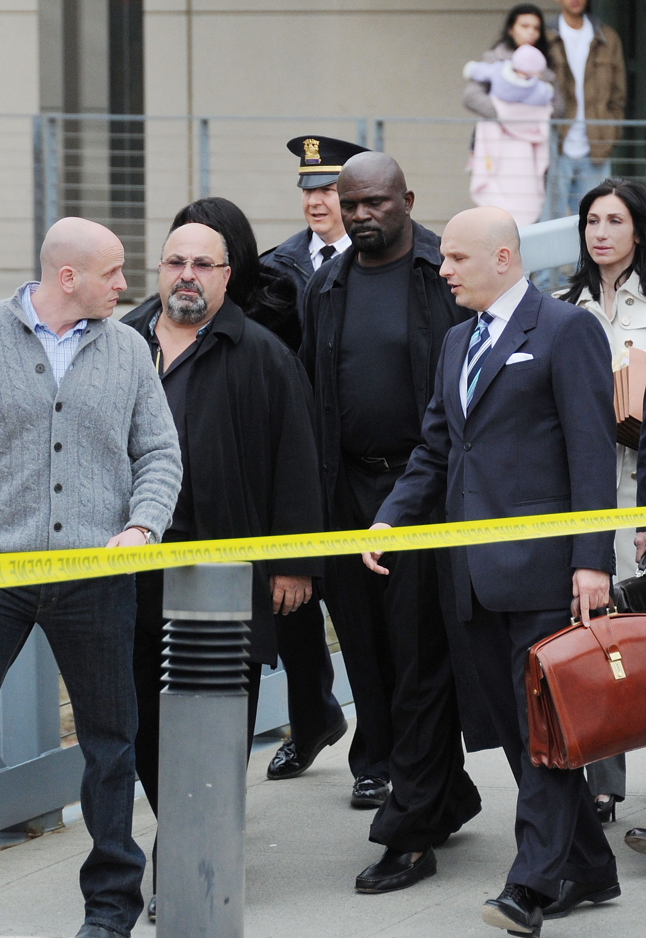 NEW CITY, NY - MARCH 22:  Former professional football player Lawrence Taylor (4rd from L) is seen leaving the courthouse after his hearing at Rockland County Courthouse on March 22, 2011 in New City, New York.  (Photo by Mike Coppola/Getty Images)