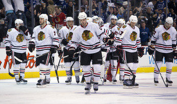 VANCOUVER, CANADA - APRIL 26: The Chicago Blackhawks wait dejectedly for the handshake with the Vancouver Canucks after losing 2-1 in overtime of Game Seven of the Western Conference Quarterfinals during the 2011 NHL Stanley Cup Playoffs on April 26, 2011