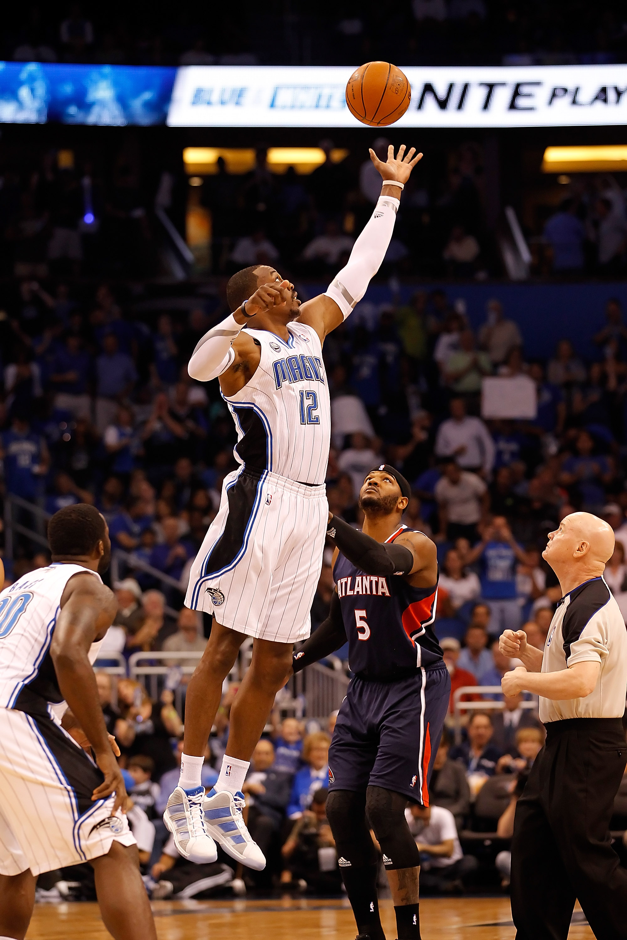 ORLANDO, FL - APRIL 26:  Dwight Howard #12 of the Orlando Magic wins the opening tip against the Atlanta Hawks during Game Five of the Eastern Conference Quarterfinals of the 2011 NBA Playoffs on April 26, 2011 at the Amway Arena in Orlando, Florida.  NOT