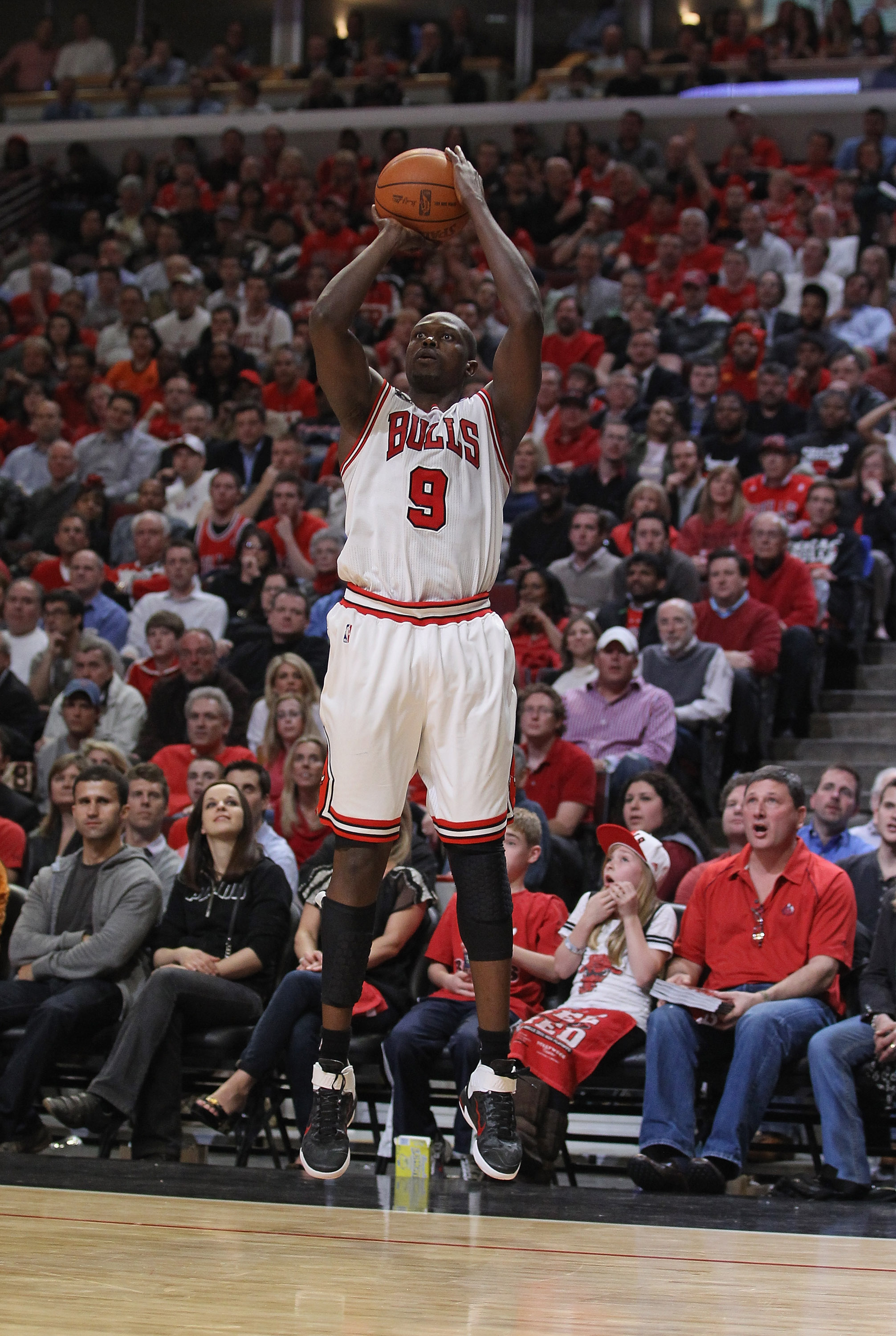 CHICAGO, IL - APRIL 26: Loul Deng #9 of the Chicago Bulls shoot a three-point shot against the Indiana Pacers in Game Five of the Eastern Conference Quarterfinals in the 2011 NBA Playoffs at the United Center on April 26, 2011 in Chicago, Illinois. The Bu