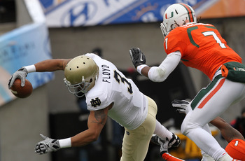 EL PASO, TX - DECEMBER 30:  Wide receiver Michael Floyd #3 of the Notre Dame Fighting Irish dives for a touchdown against Vaughn Telemaque #7 of the Miami Hurricanes at Sun Bowl on December 30, 2010 in El Paso, Texas.  (Photo by Ronald Martinez/Getty Imag