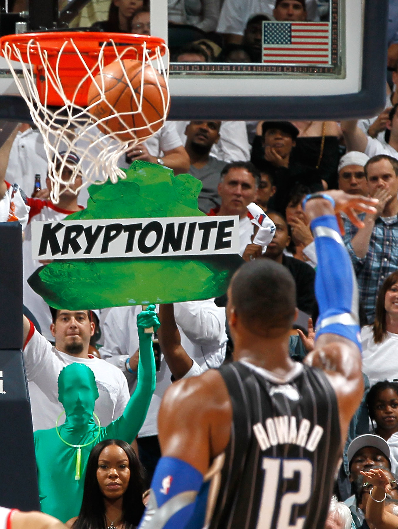 ATLANTA, GA - APRIL 28:  Dwight Howard #12 of the Orlando Magic makes a free throw while a fan holds up a neon green sign with the words 'Kryptonite' on it during Game Six of the Eastern Conference Quarterfinals in the 2011 NBA Playoffs against the Atlant