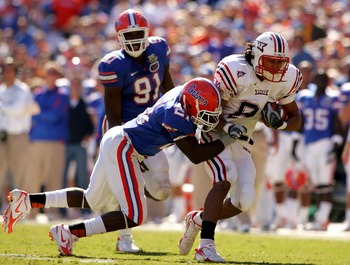 GAINESVILLE, FL - NOVEMBER 17:  Rob Housler #81 of the FAU Owls is tackled by Major Wright #21 of the Florida Gators during a game at Ben Hill Griffin Stadium on November 17, 2007 in Gainesville, Florida.  The Gators won the game 59-20.  (Photo by Sam Gre