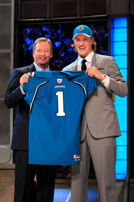 NEW YORK, NY - APRIL 28:  NFL Commissoner Roger Goodell (L) poses for a photo with Blaine Gabbert, #11 overall pick by the Jacksonville Jaguars, holds up a jersey during the 2011 NFL Draft at Radio City Music Hall on April 28, 2011 in New York City.  (Pho