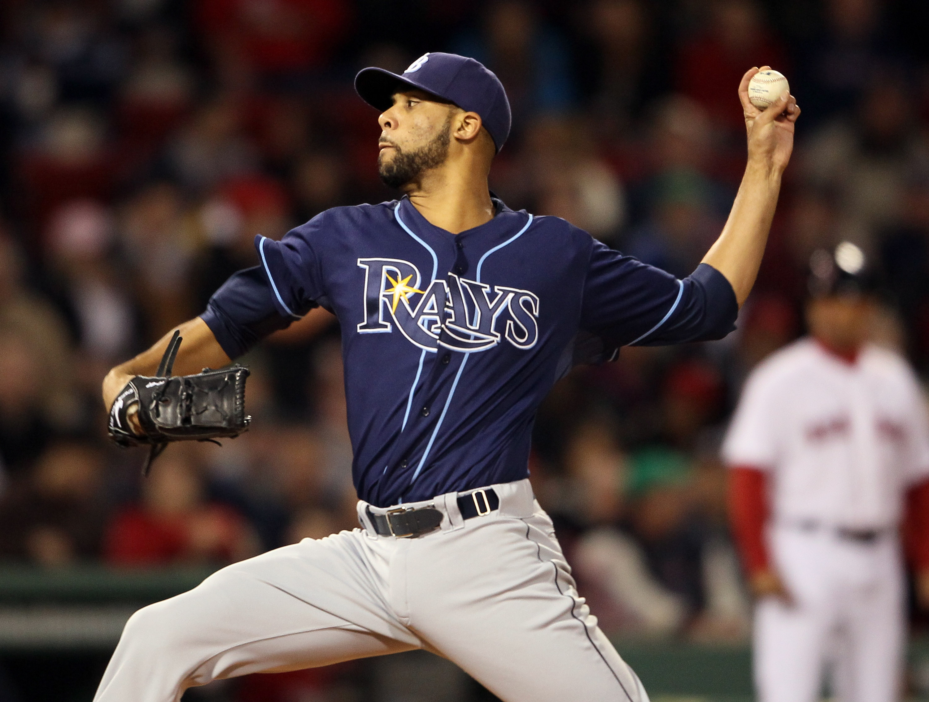 BOSTON, MA - APRIL 12:  David Price #14 of the Tampa Bay Rays delivers a pitch in the first inning against the Boston Red Sox on April 12, 2011 at Fenway Park in Boston, Massachusetts.  (Photo by Elsa/Getty Images)