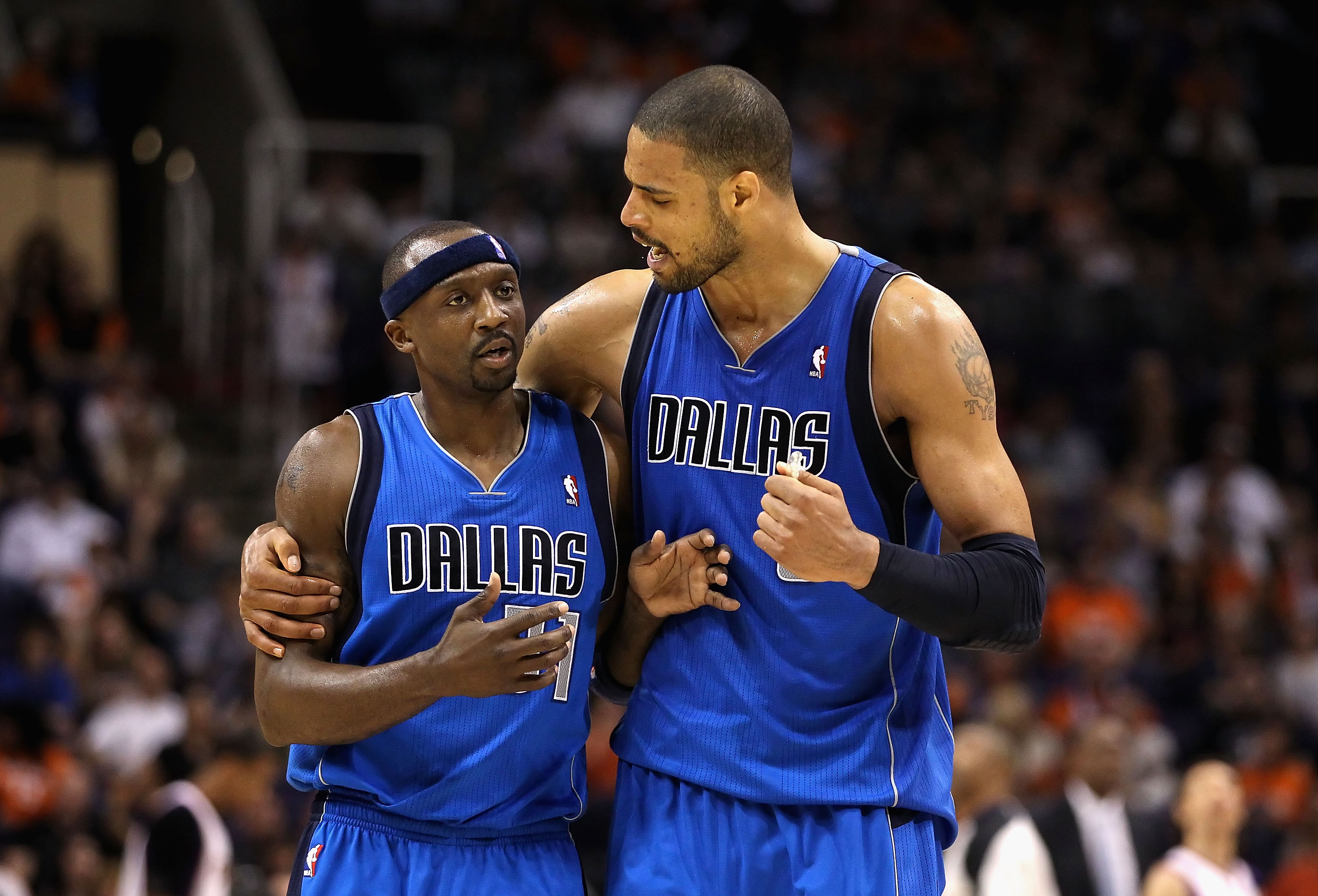 PHOENIX, AZ - MARCH 27:  Jason Terry #31 and Tyson Chandler #6 of the Dallas Mavericks react after scoring against the Phoenix Suns during the NBA game at US Airways Center on March 27, 2011 in Phoenix, Arizona. The Mavericks defeated the Suns 91-83. NOTE