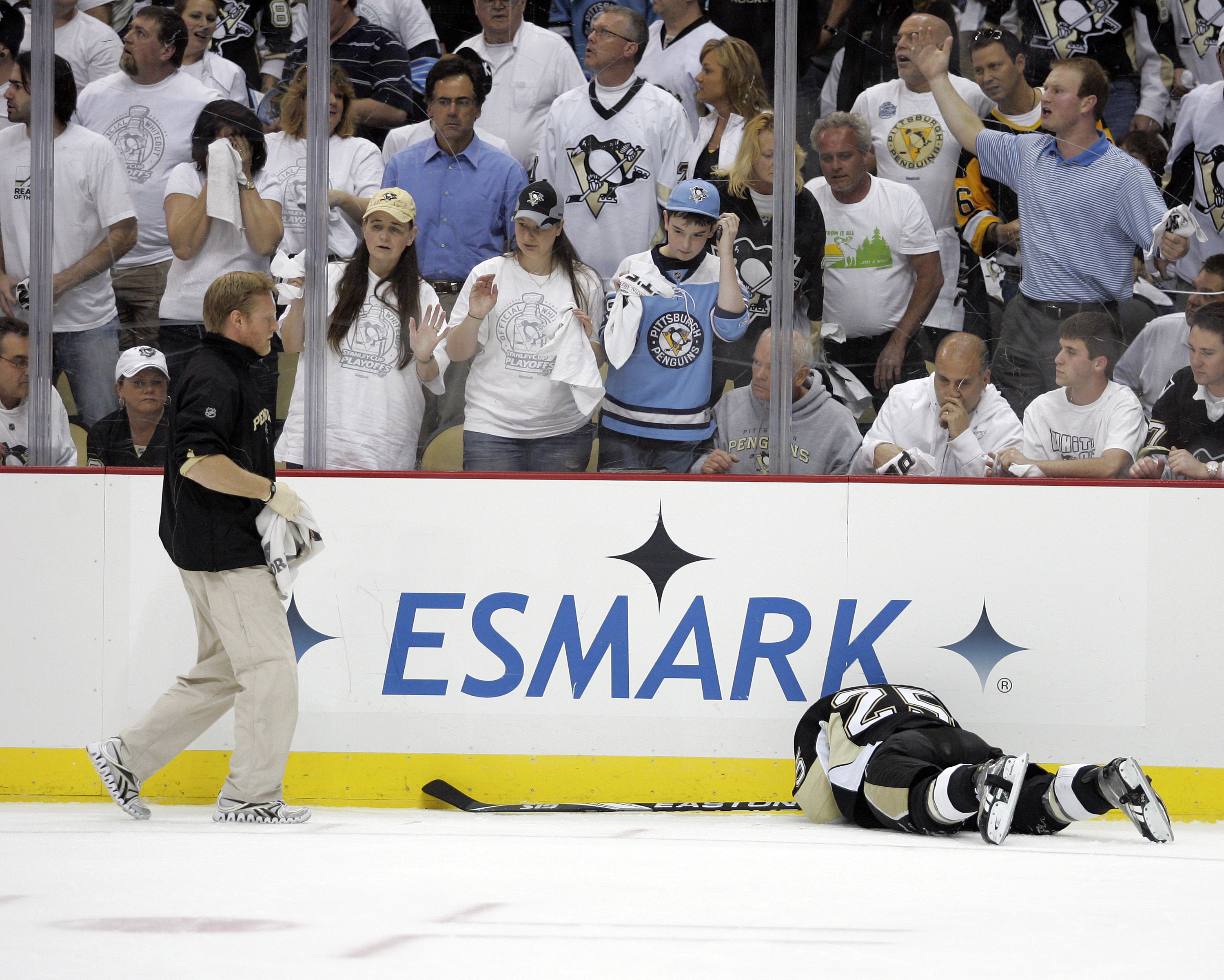 PITTSBURGH, PA - APRIL 27:  Maxime Talbot #25 of the Pittsburgh Penguins lies on the ice after being checked into the board against the Tampa Bay Lightning in Game Seven of the Eastern Conference Quarterfinals during the 2011 NHL Stanley Cup Playoffs at C