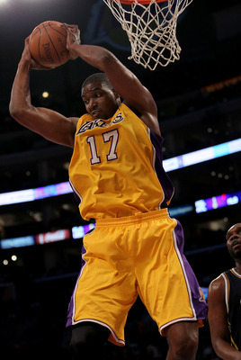 LOS ANGELES, CA - APRIL 05:  Andrew Bynum #17 of the Los Angeles Lakers grabs a rebound against the Utah Jazz at Staples Center on April 5, 2011 in Los Angeles, California. The Jazz won 86-85.  NOTE TO USER: User expressly acknowledges and agrees that, by