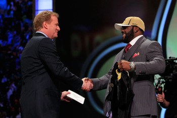 NEW YORK, NY - APRIL 28:  NFL Commissioner Roger Goodell (L) greets Mark Ingram, #28 overall pick by the New Orleans Saints, on stage during the 2011 NFL Draft at Radio City Music Hall on April 28, 2011 in New York City.  (Photo by Chris Trotman/Getty Ima