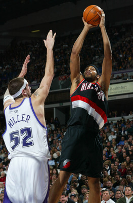 SACRAMENTO, CA - JANUARY 20:  Rasheed Wallace #30 of the Portland Trail Blazers shoots over Brad Miller #52 of the Sacramento Kings during an NBA game on January 20, 2004 at Arco Arena in Sacramento, California.  NOTE TO USER: User expressly acknowledges