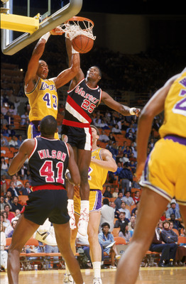 LOS ANGELES - 1987:  Mychal Thompson #43 of the Los Angeles Lakers dunks over Jerome Kersey #25 of the Portland Trail Blazers during an NBA game at the Great Western Forum in Los Angeles, California in 1987. (Photo by: Mike Powell/Getty Images)