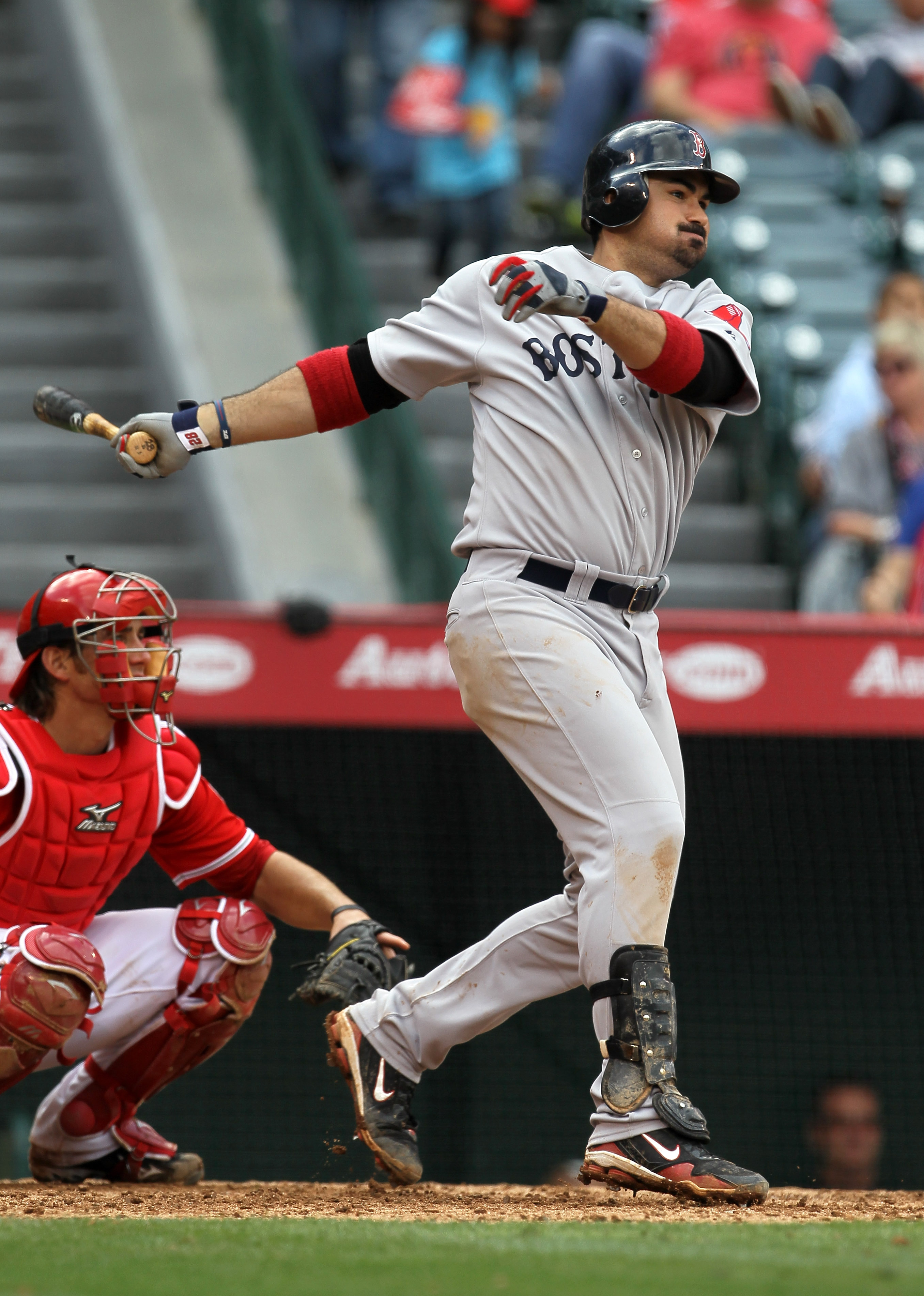 ANAHEIM, CA - APRIL 24:  Adrian Gonzalez #28 of the Boston Red Sox hits a single in the ninth inning against the Los Angeles Angels of Anaheim on April 24, 2011 at Angel Stadium in Anaheim, California.  The Red Sox won 7-0.  (Photo by Stephen Dunn/Getty I