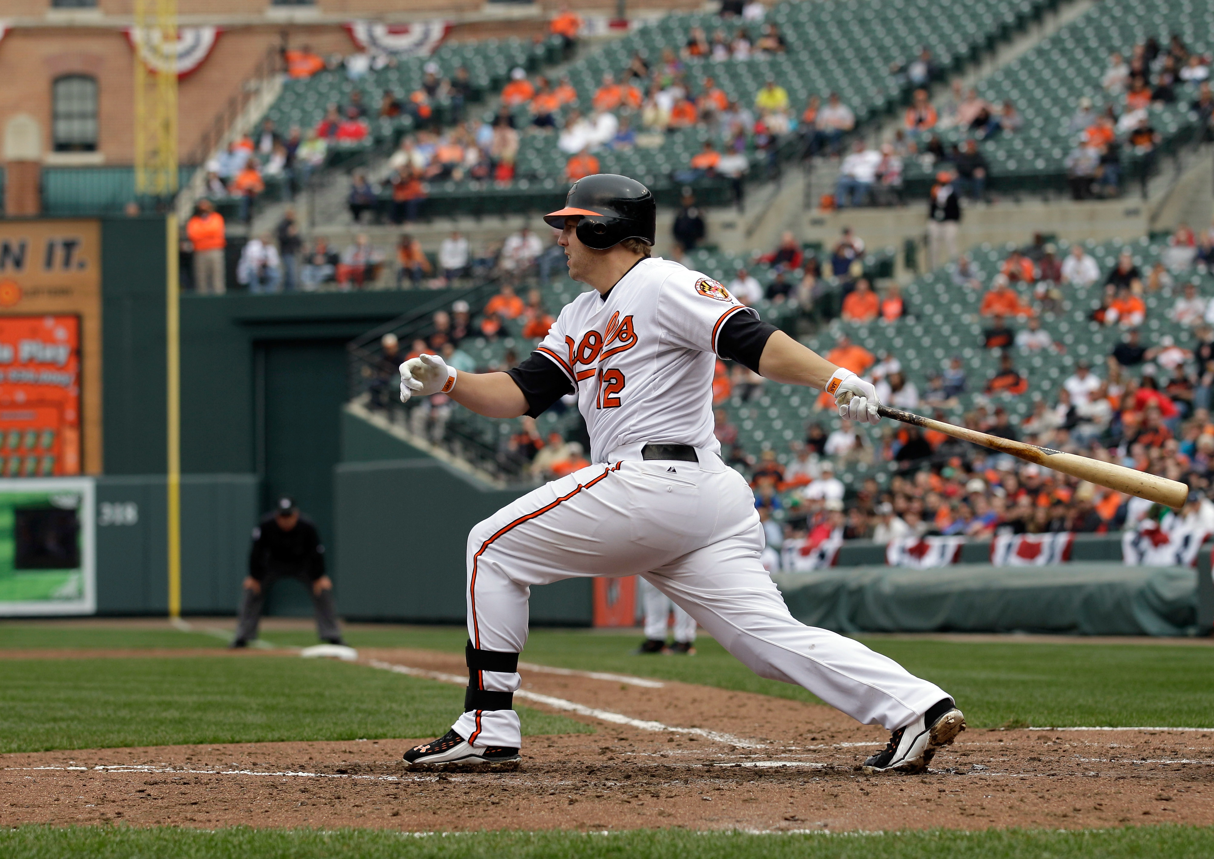 BALTIMORE, MD - APRIL 10: Mark Reynolds #12 of the Baltimore Orioles at the plate against the Texas Rangers at Oriole Park at Camden Yards on April 10, 2011 in Baltimore, Maryland.  (Photo by Rob Carr/Getty Images)
