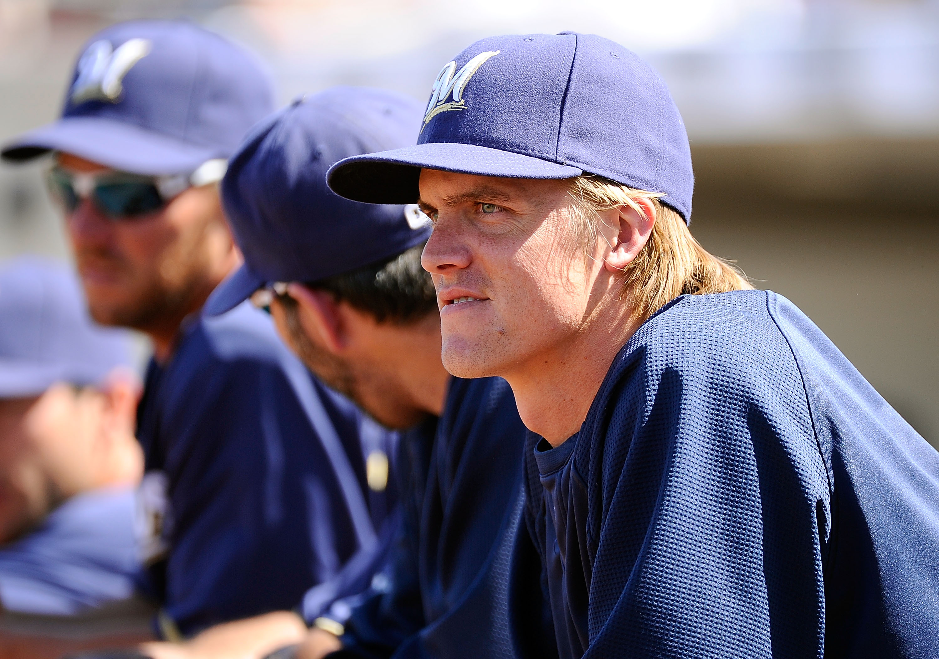 PHOENIX, AZ - MARCH 10:  Pitcher Zack Greinke #13  of the Milwaukee Brewers looks on during the spring training baseball game against Colorado Rockies at Maryvale Baseball Park on March 10, 2011 in Phoenix, Arizona.  (Photo by Kevork Djansezian/Getty Imag