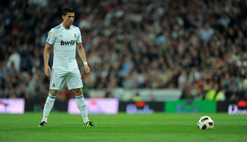 MADRID, SPAIN - APRIL 16:  Cristiano Ronaldo of Real Madrid lines up a free kick during the La Liga match between Real Madrid and Barcelona at Estadio Santiago Bernabeu on April 16, 2011 in Madrid, Spain.  (Photo by Denis Doyle/Getty Images)