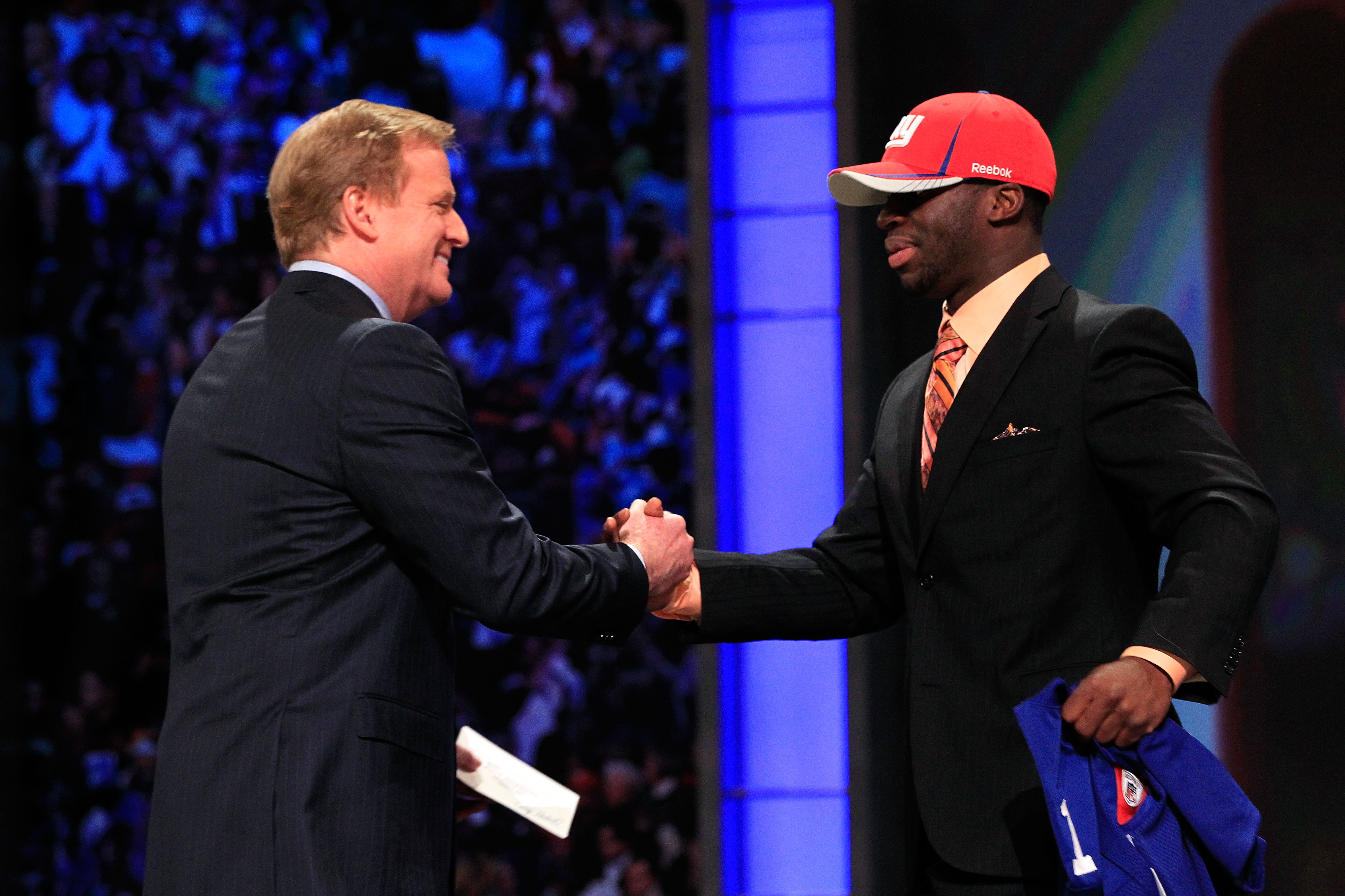 NEW YORK, NY - APRIL 28:  NFL Commissioner Roger Goodell (L) greets Prince Amukamara, #19 overall pick by the New York Giants, on stage during the 2011 NFL Draft at Radio City Music Hall on April 28, 2011 in New York City.  (Photo by Chris Trotman/Getty I