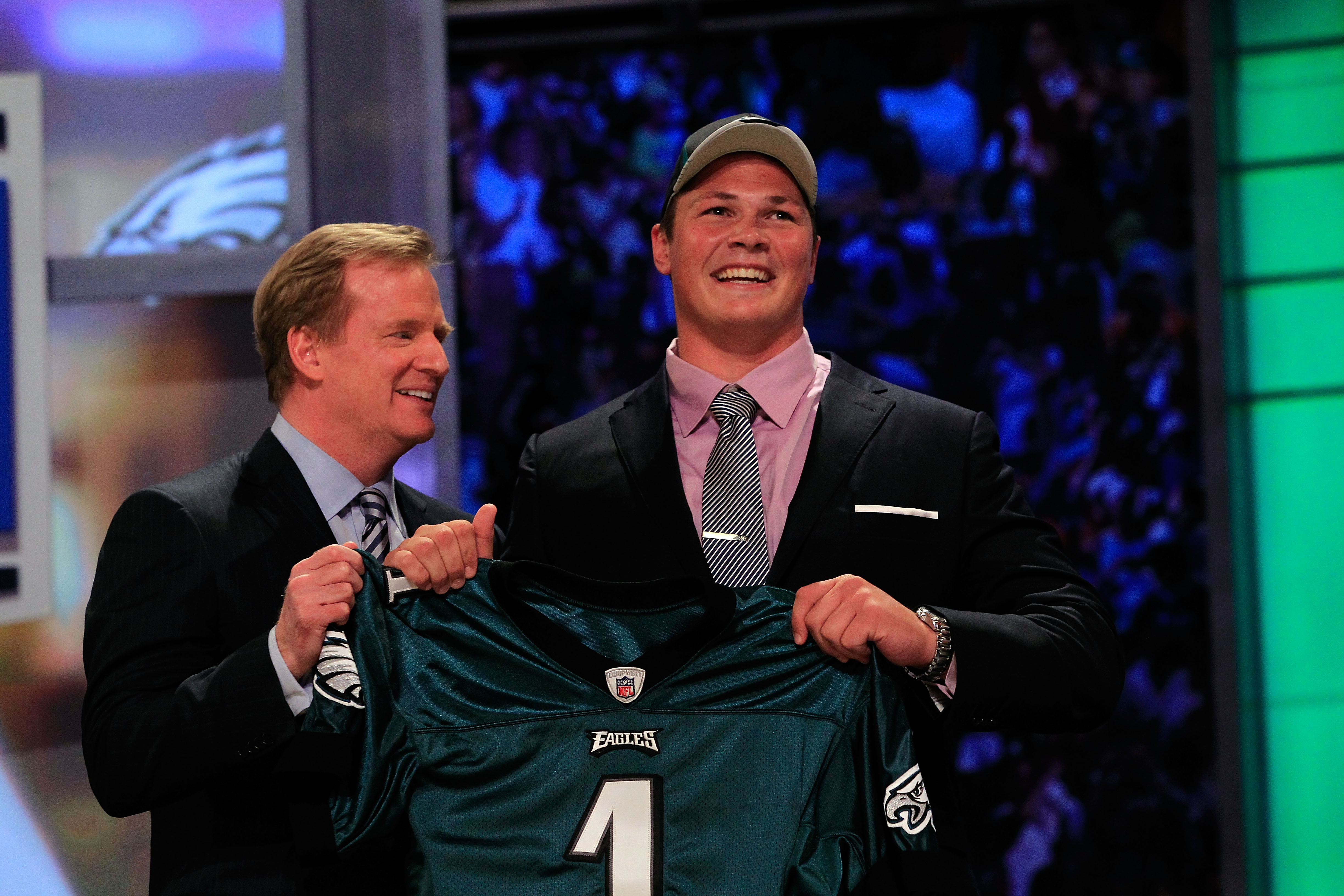 NEW YORK, NY - APRIL 28:  NFL Commissioner Roger Goodell (L) poses for a photo with Danny Watkins, #22 overall pick by the Philadelphia Eagles, on stage during the 2011 NFL Draft at Radio City Music Hall on April 28, 2011 in New York City.  (Photo by Chri