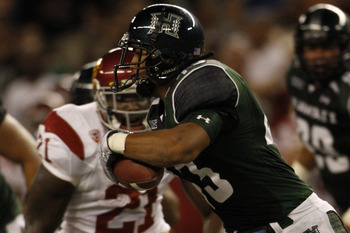 HONOLULU - SEPTEMBER 2:  Mana Silva of the University of Hawaii Warriors runs the ball after a USC fumble during second half action at Aloha Stadium September 2, 2010 in Honolulu, Hawaii. (Photo by Kent Nishimura/Getty Images)
