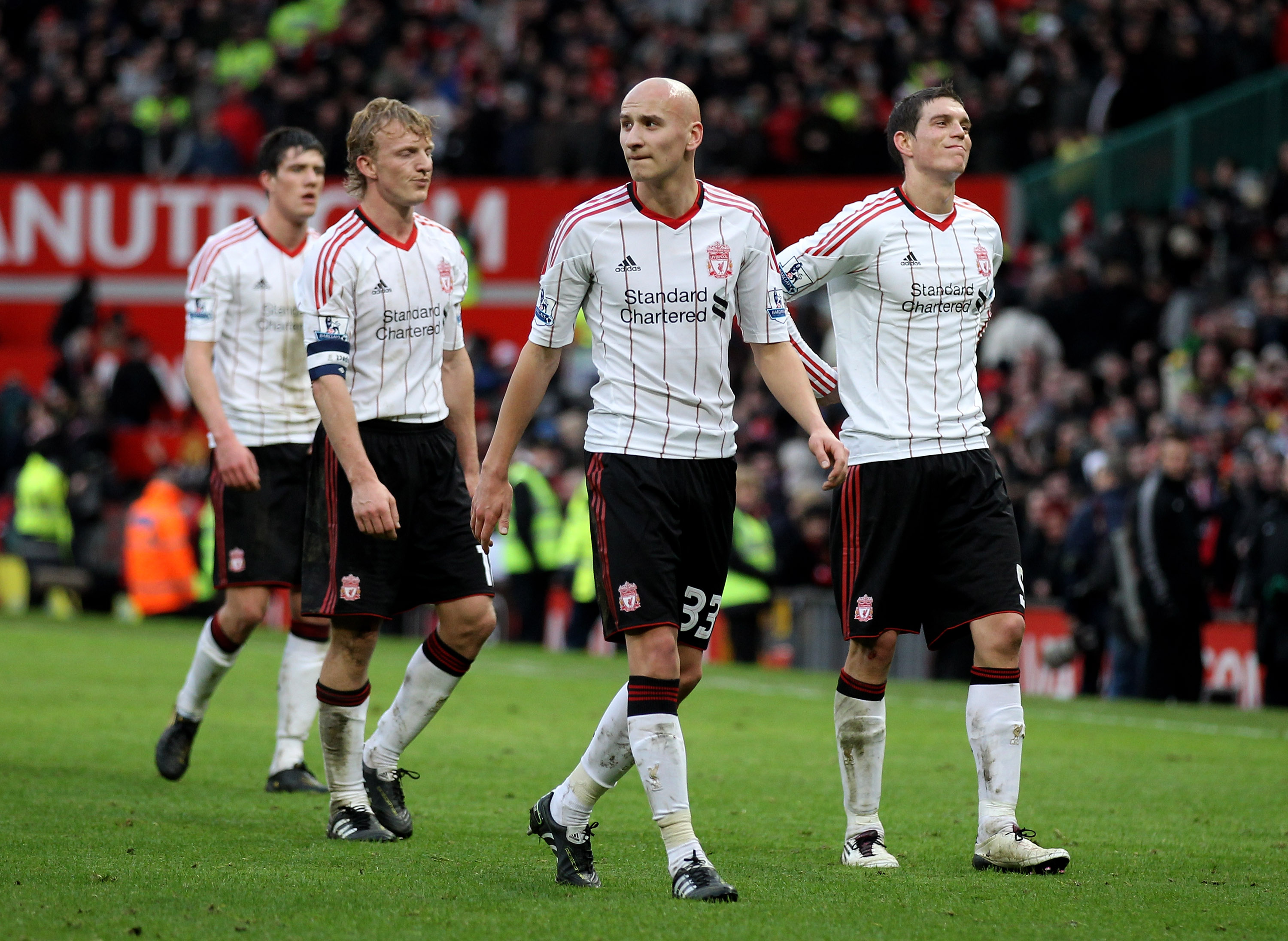 MANCHESTER, ENGLAND - JANUARY 09:   Jonjo Shelvey of Liverpool heads for the dressing room with team mates Martin Kelly (L), Dirk Kuyt and Daniel Agger (R) at the end of the FA Cup sponsored by E.ON 3rd round match between Manchester United and Liverpool
