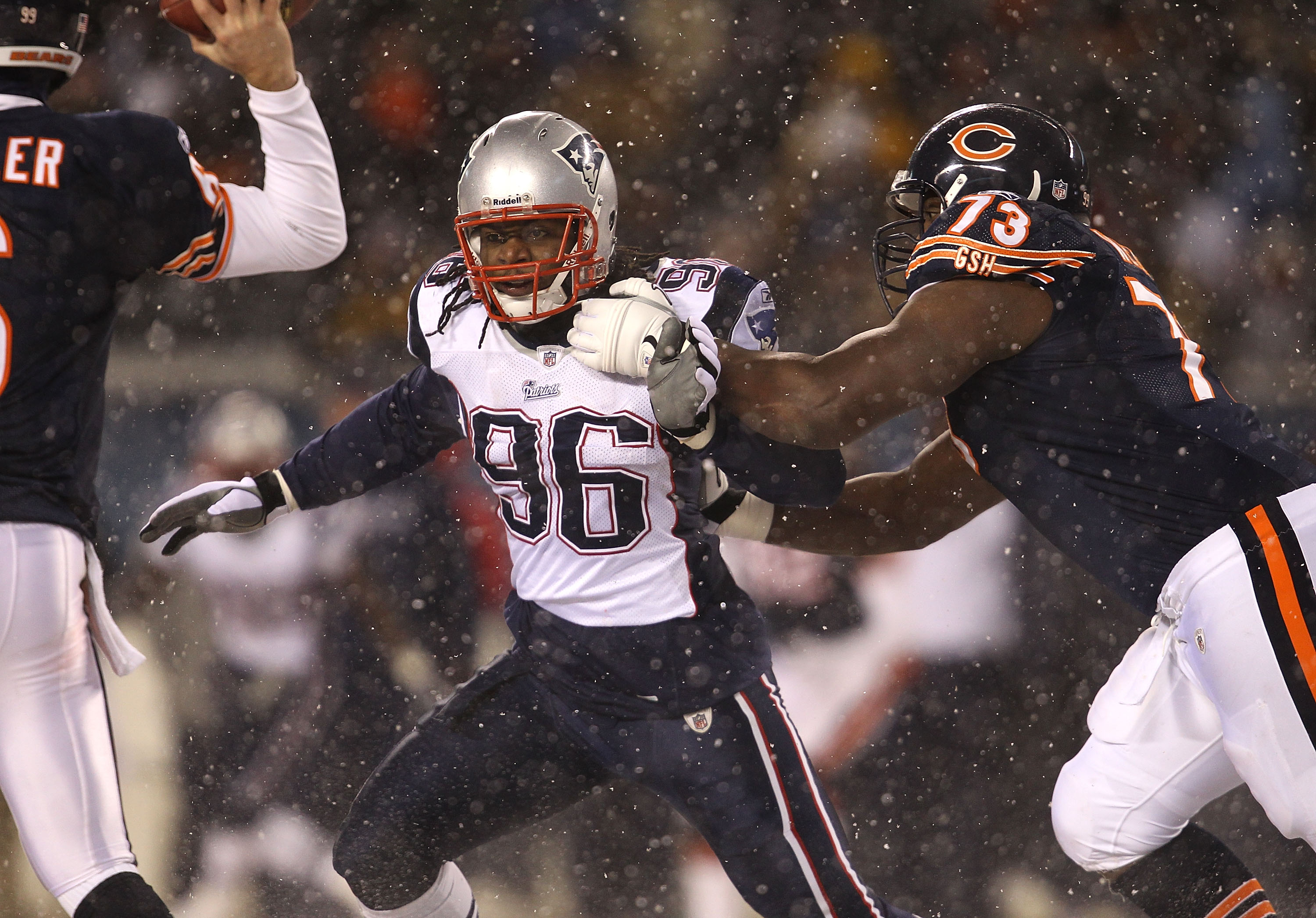 CHICAGO, IL - DECEMBER 12: Jermaine Cunningham #96 of the New England Patriots rushes past J'Marcus Webb #73 of the Chicago Bears towards Jay Cutler #6 at Soldier Field on December 12, 2010 in Chicago, Illinois. The Patriots defeated the Bears 36-7. (Phot