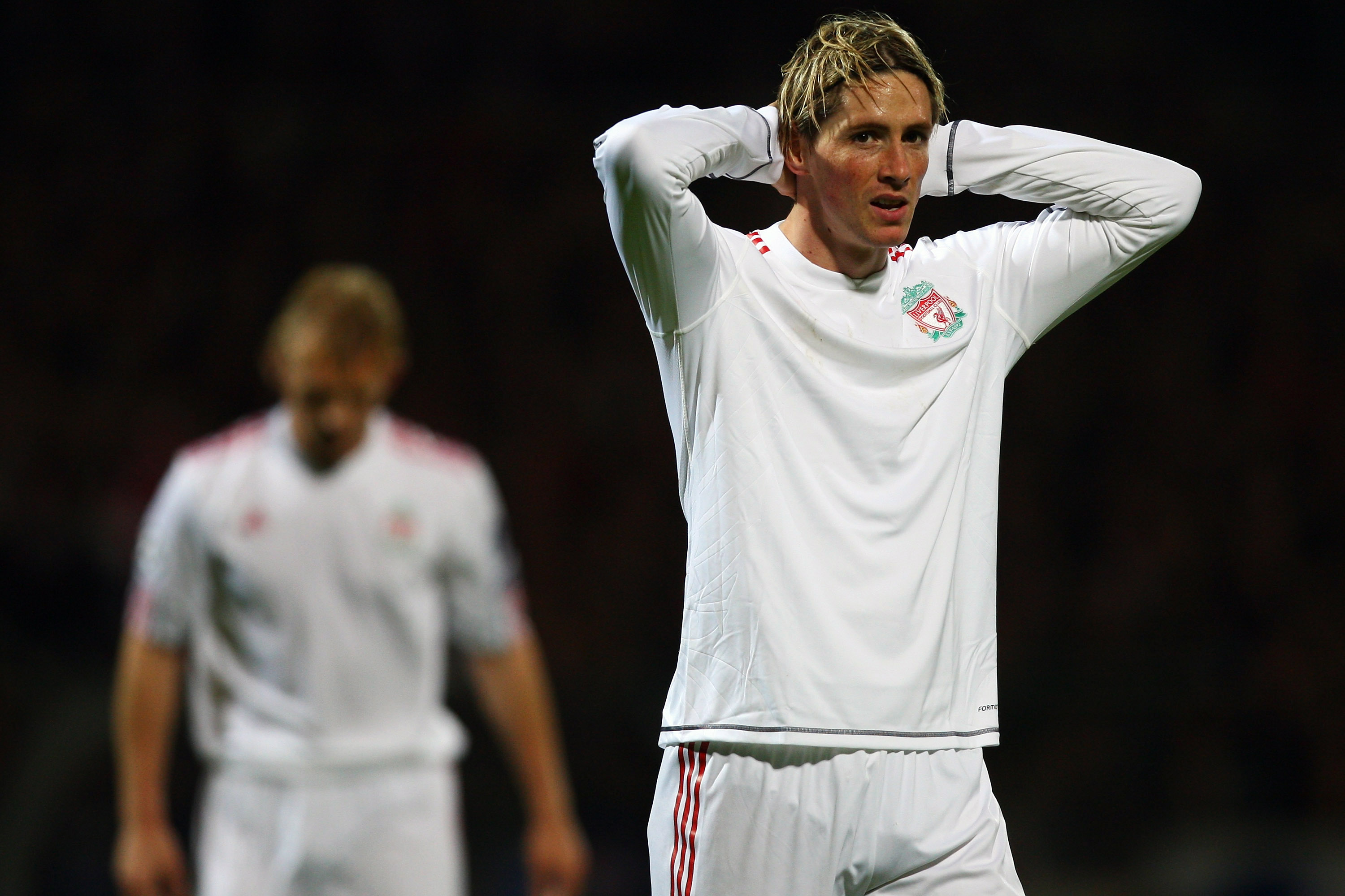 LYON, FRANCE - NOVEMBER 04:  Fernando Torres (R) of Liverpool rues a missed chance during the Lyon v Liverpool UEFA Champions League Group E match at the Stade de Gerland on November 4, 2009 in Lyon, France.  (Photo by Michael Steele/Getty Images)