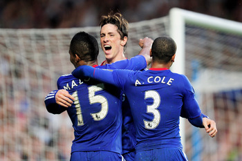 LONDON, ENGLAND - APRIL 23:  Florent  Malouda (L) of Chelsea celebrates with teammates Fernando Torres and Ashley Cole after scoring his team's third goal during the Barclays Premier League match between Chelsea and West Ham United at Stamford Bridge on A