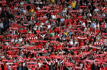 LIVERPOOL, ENGLAND - APRIL 23:  Liverpool fans show their support prior to the Barclays Premier League match between Liverpool and Birmingham City at Anfield on April 23, 2011 in Liverpool, England.  (Photo by Clive Brunskill/Getty Images)