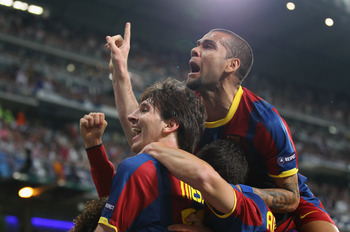 MADRID, SPAIN - APRIL 27:  Lionel Messi of Barcelona celebrates with Dani Alves after scoring his second goal during the UEFA Champions League Semi Final first leg match between Real Madrid and Barcelona at Estadio Santiago Bernabeu on April 27, 2011 in M
