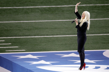 ARLINGTON, TX - FEBRUARY 06:  Singer Christina Aguilera sings the national anthem during Super Bowl XLV at Cowboys Stadium on February 6, 2011 in Arlington, Texas.  (Photo by Rob Carr/Getty Images)